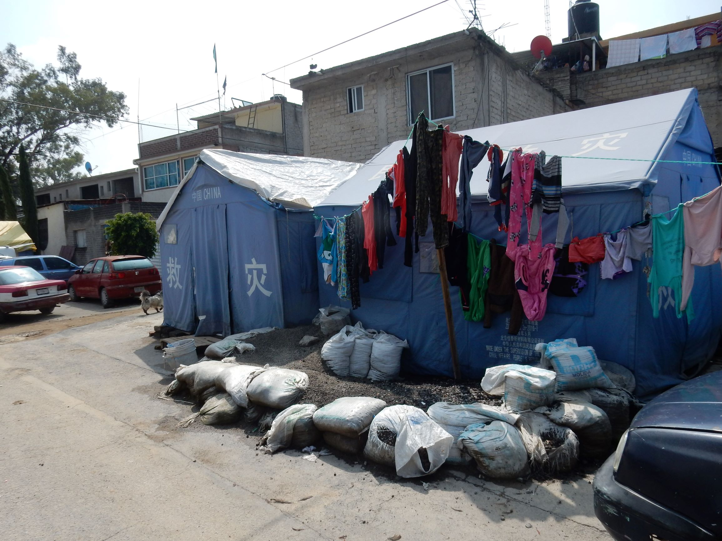 A year after the earthquake, displaced people in Iztapalapa are living in tents at risk of flooding and disease